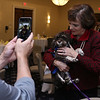"""Lowell House, Inc. held their second annual breakfast to """"Celebrate Recovery"""" at UMass Lowell Inn & Conference Center on November 28, 2016. After addressing the crowd at the event Katharine """"Kitty"""" Dukakis, the former First Lady of MA, shows off her new dog Cami a Kakapo. SUN/JOHN LOVE"""