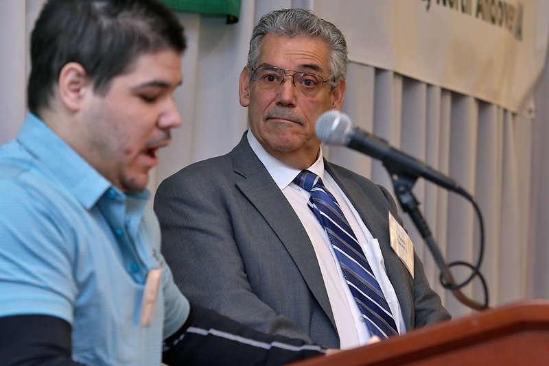 """Lowell House, Inc. held their second annual breakfast to """"Celebrate Recovery"""" at UMass Lowell Inn & Conference Center on November 28, 2016. Frank Carvalho listens to his son Tim as he talks about his addiction during the breakfast. SUN/JOHN LOVE"""