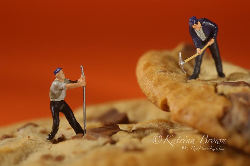 Plastic People Working on Chocolate Chip Cookies