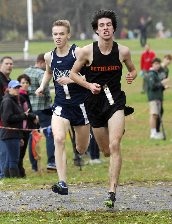 . Saratoga Springs runner Shea Weilbaker moves up on, then along and then in front of Bethlehem\'s Matt Cavaliere in the Section 2 Class A boys championship race Friday at Saratoga Spa State Park.