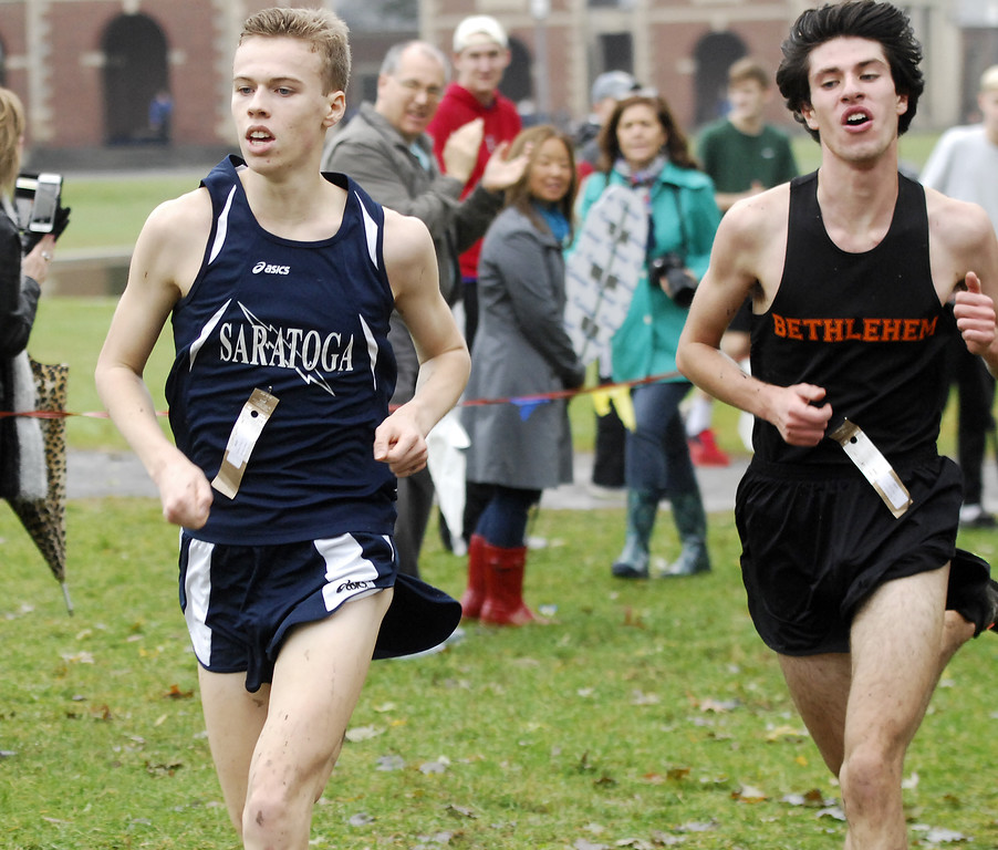 . Saratoga Springs runner Shea Weilbaker makes it past former leader Matt Cavaliere with 200-meters to go in the Section 2 Class A boys cross country championships at  Saratoga Spa State Park.