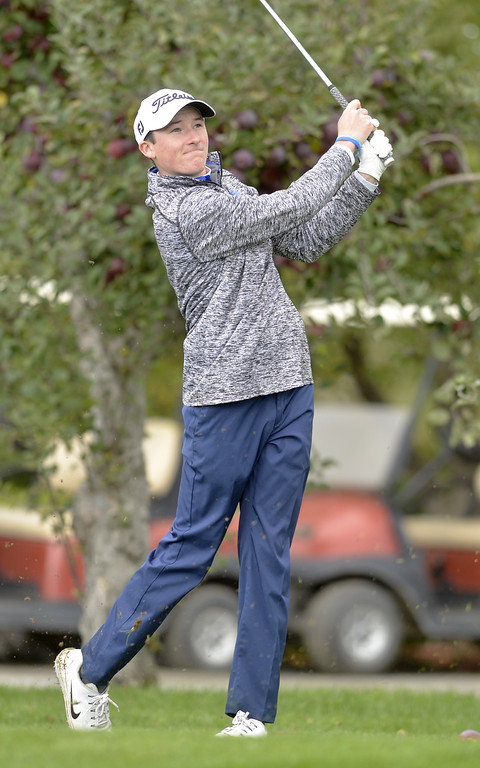. Saratoga Springs golfer Nolan Crowley swings away at the 10th tee Friday afternooon at Orchard Creek Golf Course in Altamont during the Section II state qualifier.
