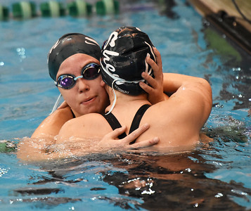 STAN HUDY - SHUDY@DIGITALFIRSTMEDIA.COM Shenendehowa junior swimmer Vicky Silaika (facing) hugs her sister, Bella, after the two competed in adjacent lanes of the 500-yard freestyle event during Saturday's Section II Division I swimming championships at the Shenendehowa Aquatics Center, Nov. 5, 2016.