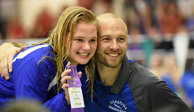 STAN HUDY - SHUDY@DIGITALFIRSTMEDIA.COM Saratoga Springs coach Josh Muldner has a photo taken with senior Victoria Breslin after her seventh-place finsih in the 100-yard butterfly event Saturday afternoon during the Section II DI swimming championships at the Shenendehowa Aquatics Center, Nov. 5, 2016.