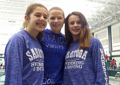 STAN HUDY - SHUDY@DIGITALFIRSTMEDIA.COM Saratoga Springs divers, from left to right, Adelle Feeley, Jennifer Van Horne and Felicity Ryan earned 47 points for the Blue Streaks Thursday night at the Section II Diving Championships, tops of all the DI teams competing Saturday in the finals.