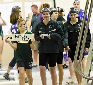 STAN HUDY - SHUDY@DIGITALFIRSTMEDIA.COM Each team is led to the blocks by a young swimmer on the pool deck prior to the Section II Divsion I swimming and diving championships Saturday, Nov. 5, 2016.