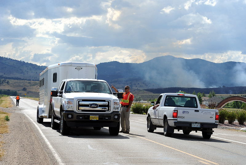Sedona Hills fire evacuees hauling their horses in a trailer talk to a Larimer County Ranger Friday, July 22, 2016, on their way out of their Sedona Hills neighborhood. (Photo by Jenny Sparks/Loveland Reporter-Herald)