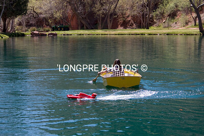 Poweboat harassing Sabot boat.