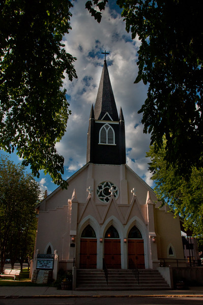 St. Columba Catholic Church, Durango CO. Photo was taken from the park and through the long hanging tree branches that perfectly framed the steeple.
