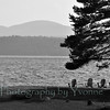 Adirondack chairs await people along the shore of Chateaugay Lake, NY