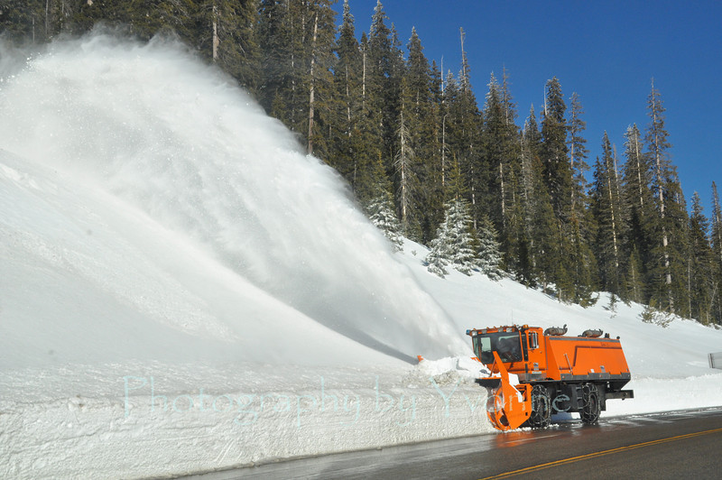 After the snowstorm on Wolf Creek Pass, Colorado. Clearing snow to widen the lanes.
