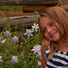 My granddaughter sitting among the Blue Columbines.