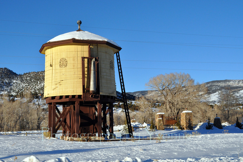 Late afternoon sun on water tank at Southfork, CO