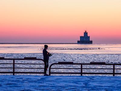 He's there almost every day, photographing the sunrise as part of his run. #project365 #OMDEM1MKII#milwaukeelakefront  #DearMKE #OnlyinMilwaukee #mkemycity #milwaukeewi #discovermilwaukee #lakemichigansunrise #ig_milwaukee #milwaukeesunrise#portofmilwaukee #street_mke #getolympus #harbordistrictmke #olympusomd #microfourthirds #milwaukeepierheadlight
