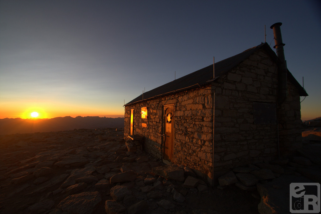 Sun sets on the shelter on top of Mt. Whitney, the highest mountain in the contiguous United States with an elevation of 14,505 feet (4,421 m).