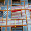 American flag showing through window in Central Heating Plant at SUNY Buffalo State College.