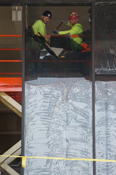 Glass being removed for replacement on the E.H. Butler Library at Buffalo State College.