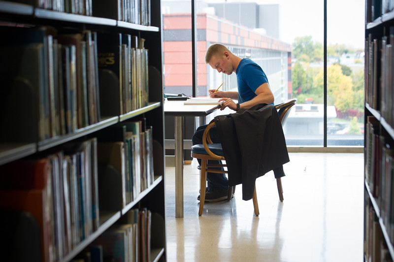 Student studying in E.H. Butler Library at SUNY Buffalo State College.