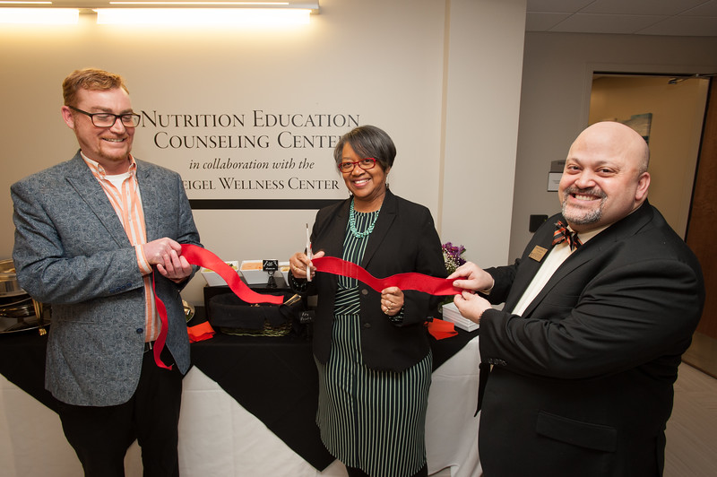 President Katherine Conway-Turner cutting the ribbon for the Nutrition Education Counseling Center at Buffalo State College.