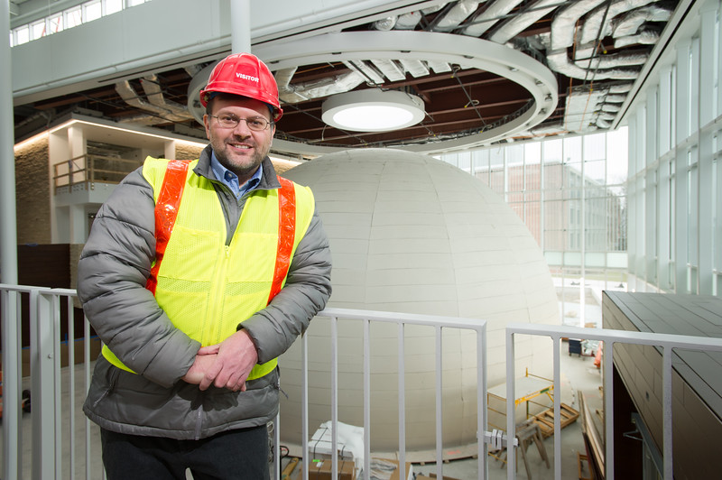 Whitworth Ferguson Planetarium director, Kevin Williams with planetarium under construction at SUNY Buffalo State College.