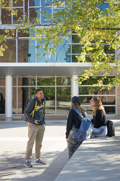 Student talking in Plaza  at SUNY Buffalo State College.