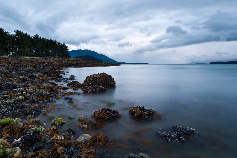 A long exposure smooths the water in this August evening shot of Auke Bay and Point Louisa, one of my personal favorites. Taken August 10th, 2009.