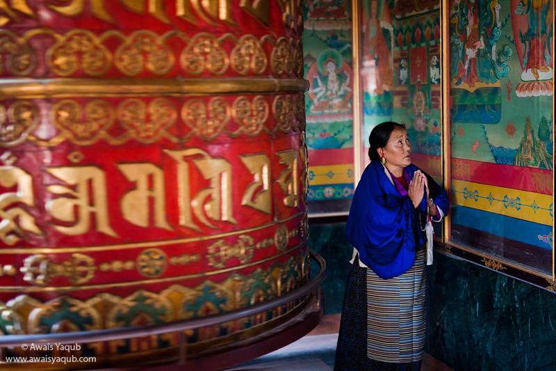 Prayer Wheel and Budhist Woman