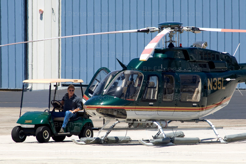 EXCLUSIVE---<br /> Harrison Ford waiting a private jet with family and friend,after they land,they take off for four hours with Harrison's helicopter from Santa Monica Airport,California.