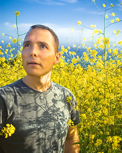 Me in Malibu, CA standing in really tall yellow flowers... testing out my new overhead light diffuser. Thought about shooting a portrait here, but it is very difficult maneuvering through the tall flowers!  Spring 2007.