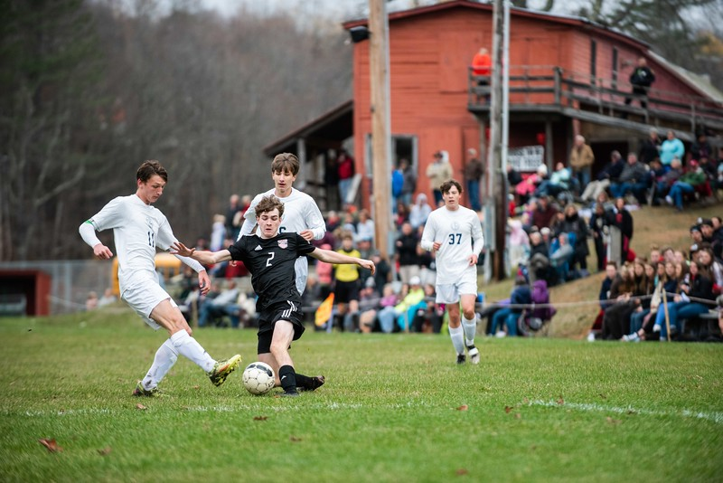 KELLY FLETCHER, REFORMER CORRESPONDENT -- Colin McHale fights to keep possession against Rivendell during Tuesday's playoff game.  Twin Valley took the win 3-1.