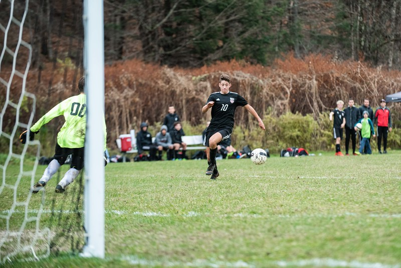 KELLY FLETCHER, REFORMER CORRESPONDENT -- Lucas Messing brings the ball in for a shot on goal during Twin Valley's playoff game vs. Rivendell on Tuesday.  Twin Valley took the win 3-1.