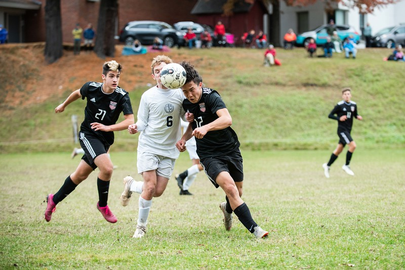 KELLY FLETCHER, REFORMER CORRESPONDENT -- Twin Valley's Izaak Park (#12) heads the ball past J. Vogelein (#6) during their playoff game vs. Rivendell on Tuesday.  Twin Valley took the win 3-1.
