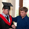 ERSU Seminary Graduation 2010 - student body president Gutsulyuk helps Graduate Eduard Shevchuk arrange his graduation regalia
