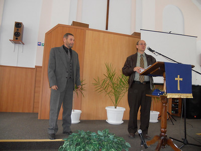 ERSU Seminary President Quarterman presents Istoki Bible College certificate to Vitali Voytenko in Belgorod-Dnestrovsky Presbyterian Church