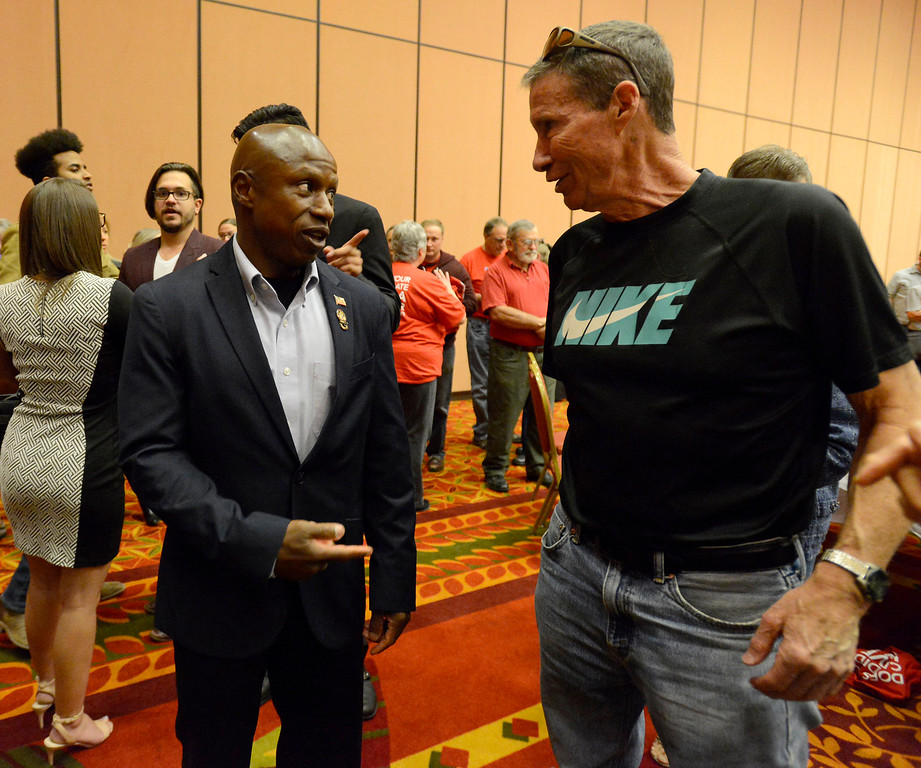 Darryl Glenn talks with his junior high PE teacher Phil Johnson, right, Wednesday, Oct, 26, 2016, after Ted Cruz spoke to stump for Glenn at Embassy Suites in Loveland. (Photo by Jenny Sparks/Loveland Reporter-Herald)