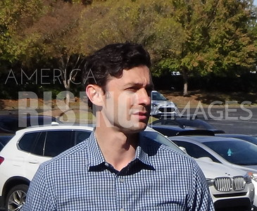 Jon Ossoff attends yard sign pick up drive thru in Atlanta, GA