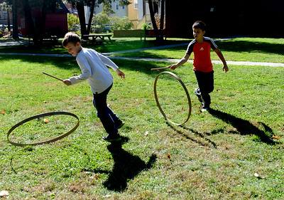 Tania Barricklo-Daily Freeman                      Gavin McIlwee,8, left, son of Shana and Donde of Poughkeepsie, and Cooper Jaffe,9, son of Brian and Nuch of Accord, try their hand at 'hoop and stick', an 18th century game. The boys are part of  Hudson Valley Homeschoolers and visited the Senate House State Historic Site Wednesday as part of the Senate House's 18th Century Childhood Program.