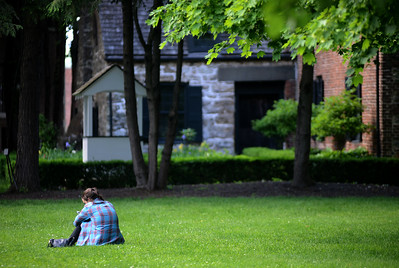 Tania Barricklo-Daily Freeman                      Brianna Hafner of Cottekill takes a break from work Thursday on the lawn at the Senate House State Historic Site  in Uptown Kingston, N.Y.