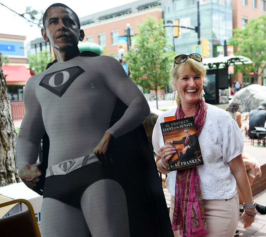 . Julie Gibson poses with her book next to a cutout of a Super Obama. Al Franken, Democratic Senator from Minnesota, spoke and signed books at the Boulder Bookstore on Saturday. For more photos and a video, go to www.dailycamera.com.  Cliff Grassmick  Staff Photographer June 17, 2017