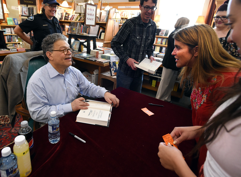 . Al Franken signs  a book for Christine Martinez. Al Franken, Democratic Senator from Minnesota, spoke and signed books at the Boulder Bookstore on Saturday. For more photos and a video, go to www.dailycamera.com.  Cliff Grassmick  Staff Photographer June 17, 2017