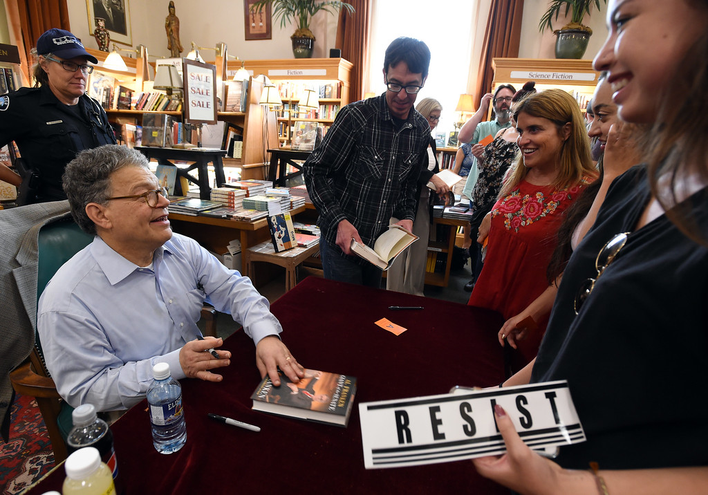 . Al Franken signs books for Christine Martinez, left, Aisen Ngo, and Isabelle Martinez. Al Franken signs books for Christine Martinez, left, Aisen Ngo, and Isabelle Martinez. Al Franken, Democratic Senator from Minnesota, spoke and signed books at the Boulder Bookstore on Saturday. For more photos and a video, go to www.dailycamera.com.  Cliff Grassmick  Staff Photographer June 17, 2017