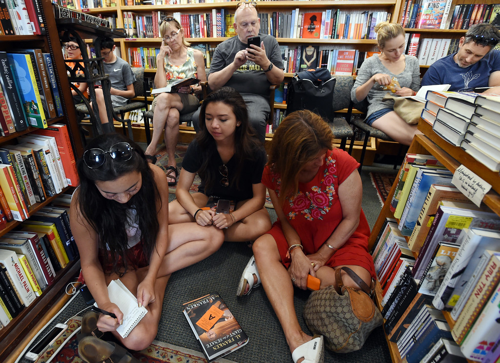 . Isabelle Martinez, left, Aisen Ngo, and Christine Martinez, wait for Al Franken to arrive. Al Franken, Democratic Senator from Minnesota, spoke and signed books at the Boulder Bookstore on Saturday. For more photos and a video, go to www.dailycamera.com.  Cliff Grassmick  Staff Photographer June 17, 2017