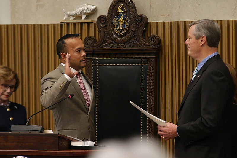 Newly elected Dean Tran gets sworn in by Gov. Charlie Baker on Wednesday morning at the State House. SENTINEL & ENTERPRISE/JOHN LOVE