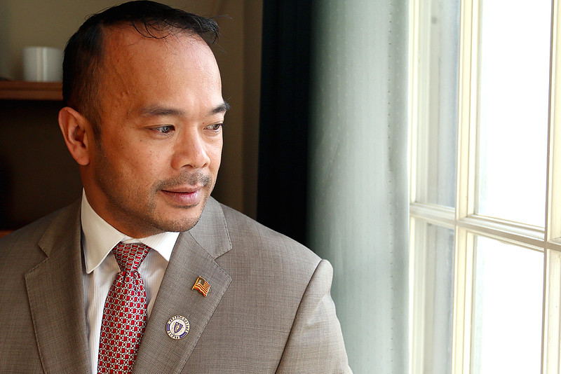 Newly sworn in Dean Tran looks out the window of his new senate office at the State House on Wednesday afternoon after having been sworn in by Gov. Charlie Baker. SENTINEL & ENTERPRISE/JOHN LOVE