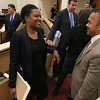 Newly sworn in Senator Dean Tran has a ggo laugh with Senator Linda Dorcena Forry at the State House on Wednesday afternoon. SENTINEL & ENTERPRISE/JOHN LOVE