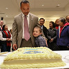 Newly sworn in Senator Dean Tran showslooks over a cake withhis son Dean, 6, at his party at the State House on Wednesday afternoon after having been sworn in by Gov. Charlie Baker. SENTINEL & ENTERPRISE/JOHN LOVE