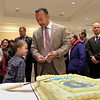 Newly sworn in Senator Dean Tran shows off his new state house business cards to his son Dean, 6, at his party at the State House on Wednesday afternoon after having been sworn in by Gov. Charlie Baker. SENTINEL & ENTERPRISE/JOHN LOVE