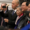 Dean Tran's mother Dong Tran and Brother's Sebastien, with phone, and Khiem, in glasses, listen as he addresses the senate, family and friends after having been sworn in by Gov. Charlie Baker on Wednesday at the state house. SENTIENL & ENTERPRISE/JOHN LOVE