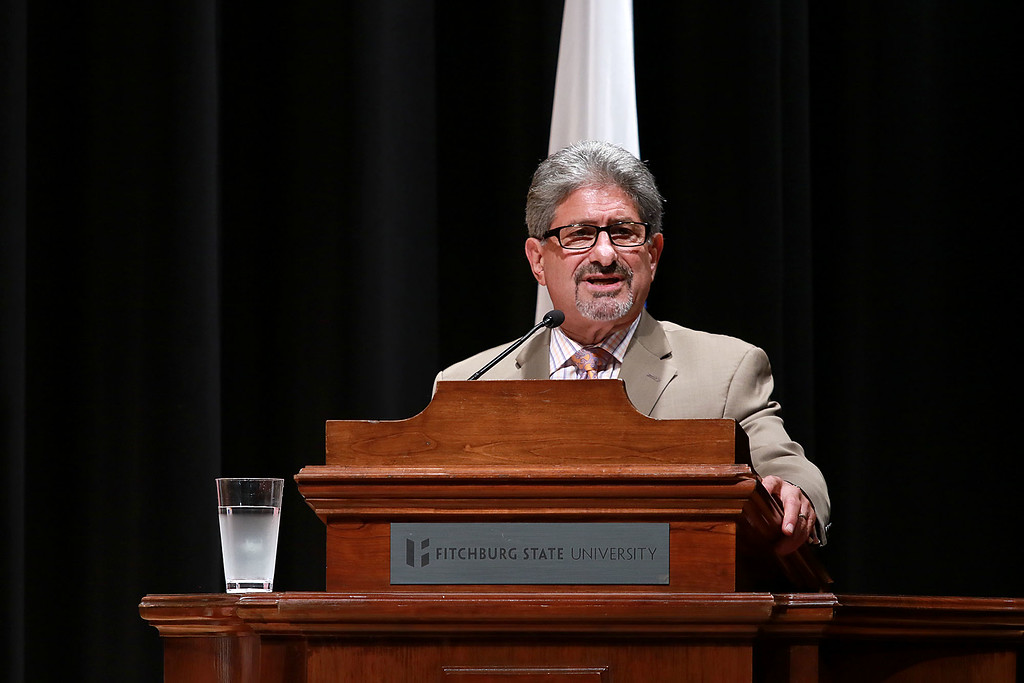. Senator Elizabeth Warren held a town hall in Fitchburg on Thursday night in Weston Auditorium at Fitchburg State University. Fitcburg Mayor Stephen DiNatale addresses the crowd at the town hall just before Warren came on. SENTINEL& ENTERPRISE/JOHN LOVE