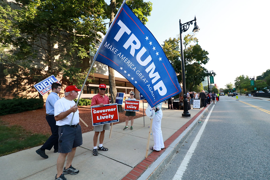 . Senator Elizabeth Warren held a town hall in Fitchburg on Thursday night in Weston Auditorium at Fitchburg State University. Anthony Fiduccia of Leominster holds a Trump flag outside the auditorium before the town hall. SENTINEL& ENTERPRISE/JOHN LOVE
